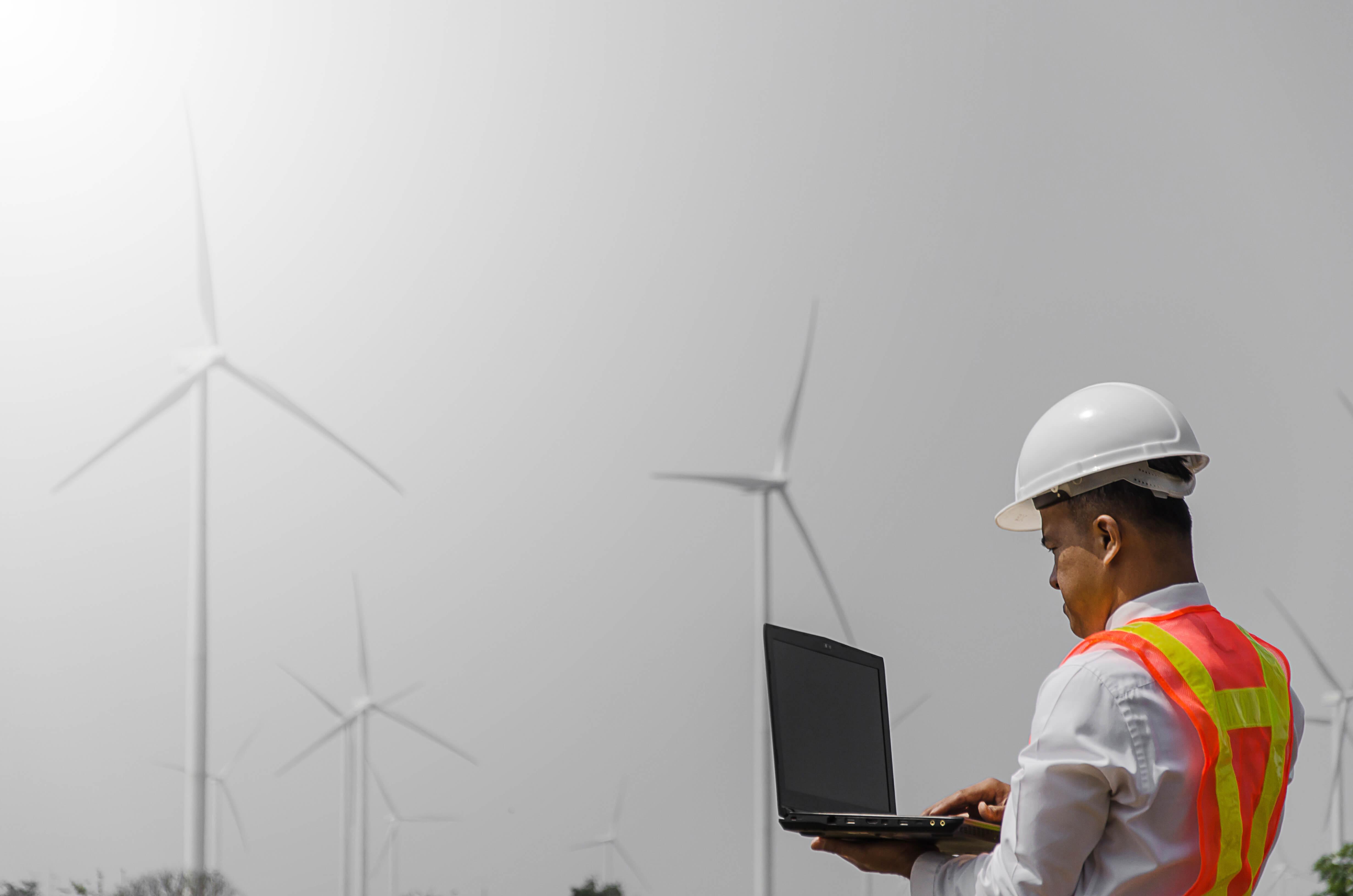 Senior Engineer, Asian men are monitoring system wind turbine el